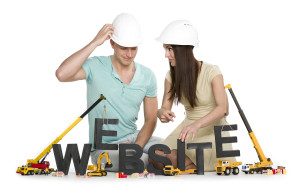 Website under construction: Friendly man and woman building webs
